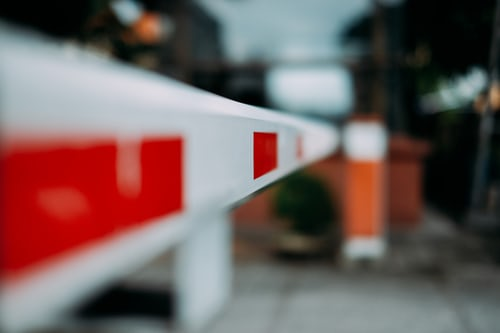 Image of a road barrier, symbolising barriers for self-management and employees to do their best work.